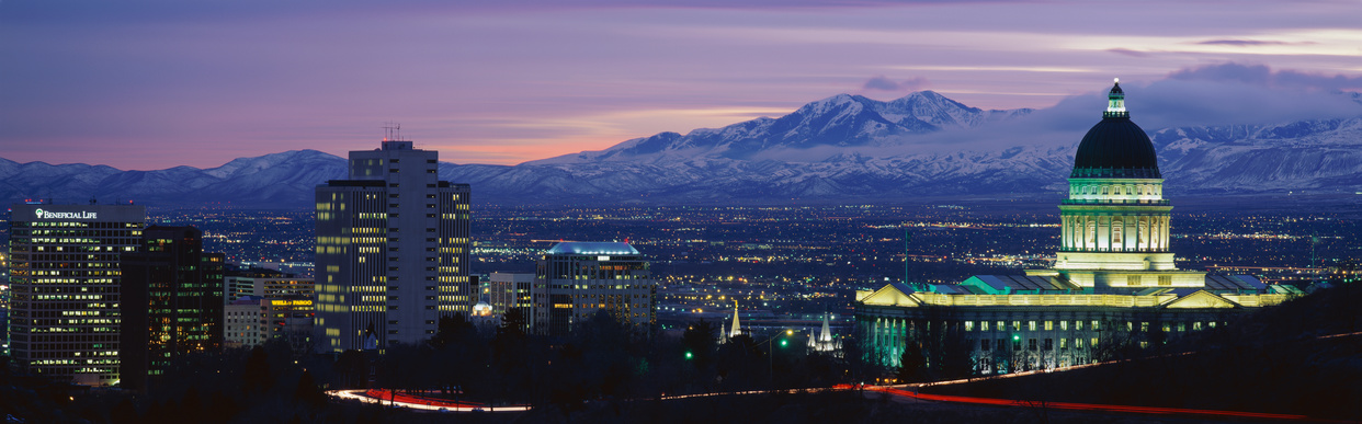 This is the State Capitol, Great Salt Lake and Snow Capped Wasatch Mountains at sunset. It will be the winter Olympic city for the year 2002.