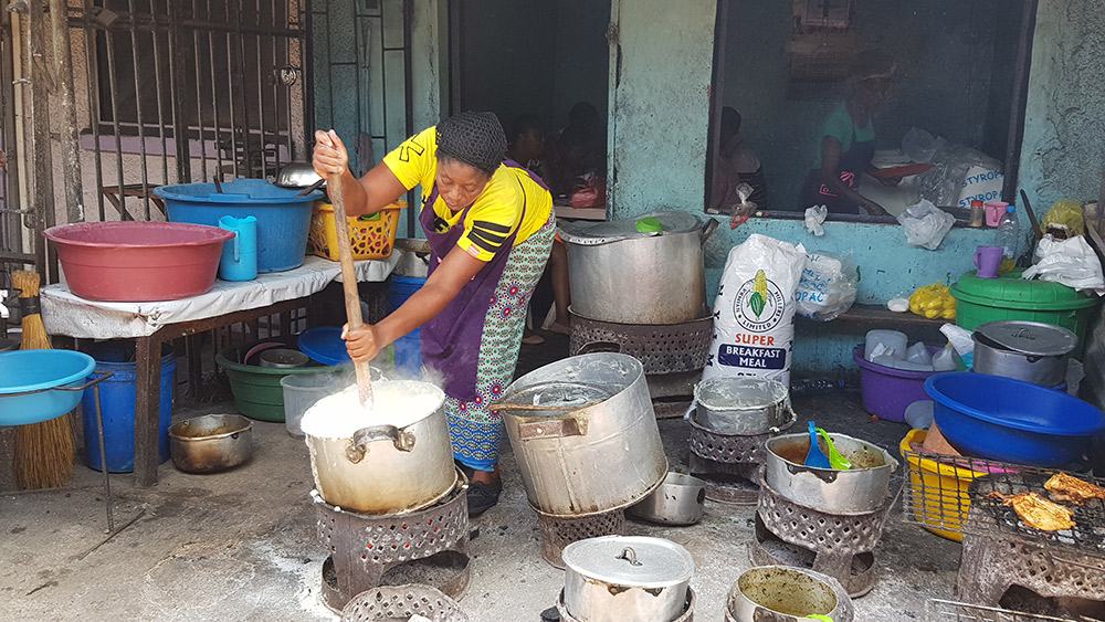 Cooking ugali over charcoal in Arica